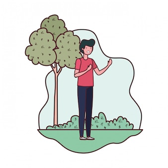 Young man in landscape with trees and plants