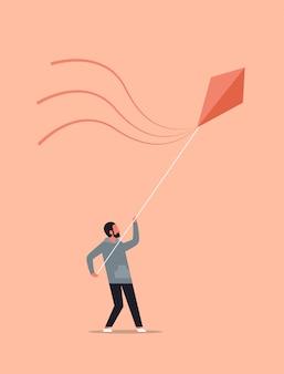 Young man launching kite