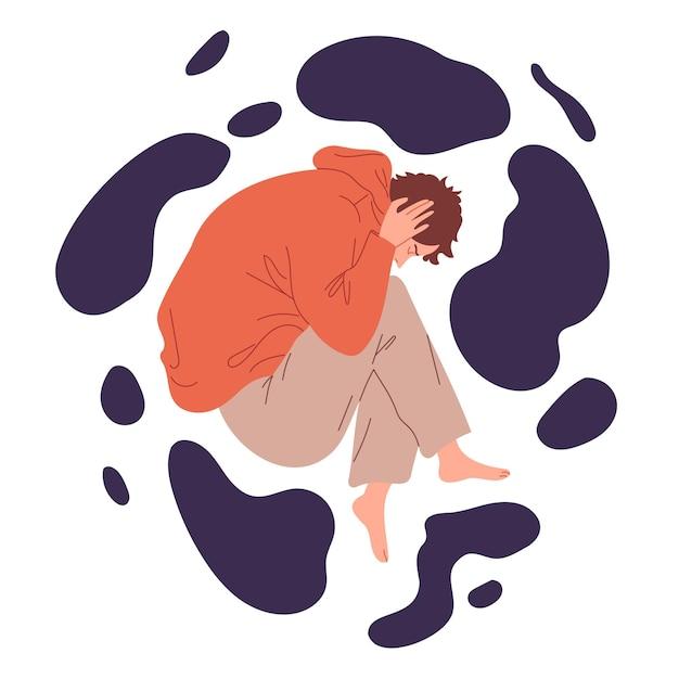 Молодой человек лежит, свернувшись клубочком, от болезненных эмоций.