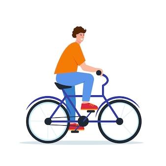Bycicleの若い男笑顔の幸せな少年は自転車に乗る
