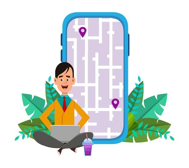 젊은 남자 야외 좌석 경로 및 위치 확인. 지도와 함께 모바일 및 컴퓨터 응용 프로그램 사용 .
