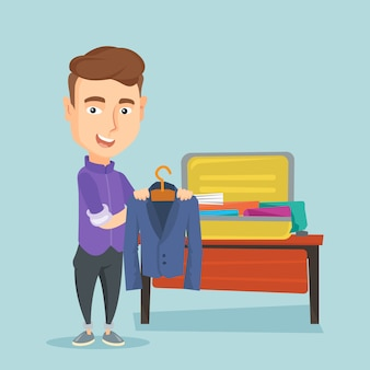 Young man packing his suitcase vector illustration