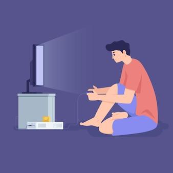 若い男が夜にオンラインビデオゲームをプレイ