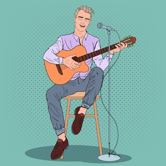 若い男がギターを弾く