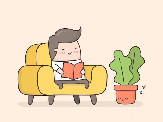 Young man reading in cozy living room.