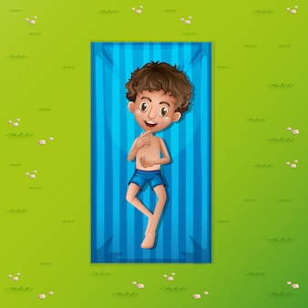 A young man relaxing on mat