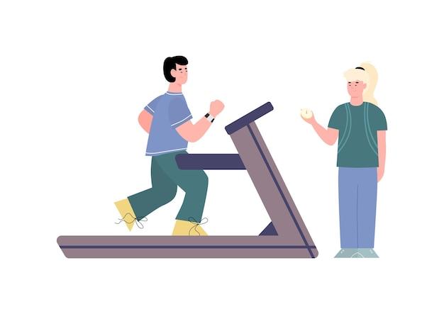 Молодой человек работает на беговой дорожке в тренажерном зале под руководством спортивного тренера женщины