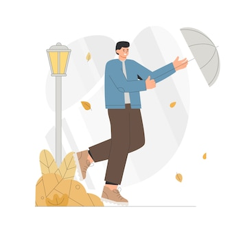Young man runs with an umbrella in a windy autumn.