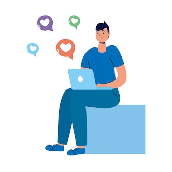 Young man seated using laptop and social media icons.