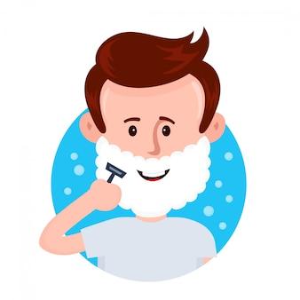 若い男が泡で顔を剃る。