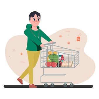 Молодой человек делает покупки в универмаге супермаркета