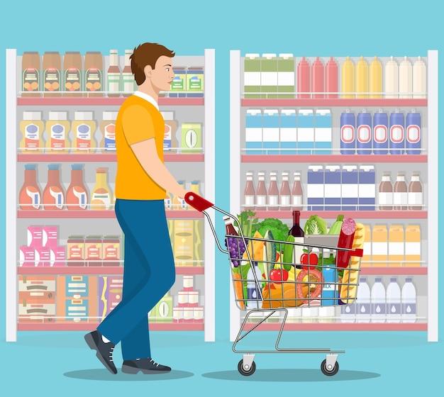 食料品の買い物をする若い男