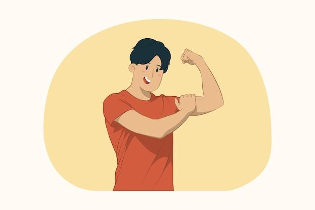 Молодой человек показывает концепцию мышц бицепса