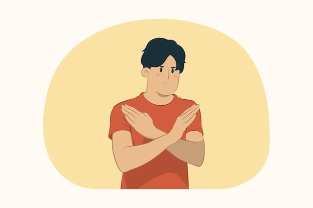 Молодой человек показывает жест стоп со скрещенными руками