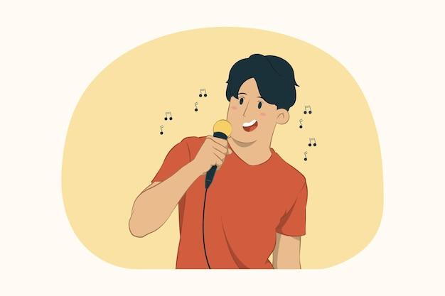 若い男がマイクの概念で歌を歌う