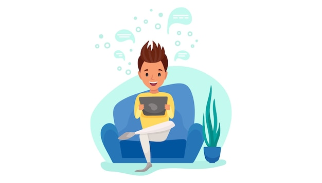 Young man sit with tablet on the sofa at home. distance working. freelance, online education