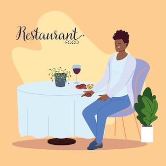 ワインのイラストデザインのグラスで夕食を食べて美しいレストランに座っている若い男