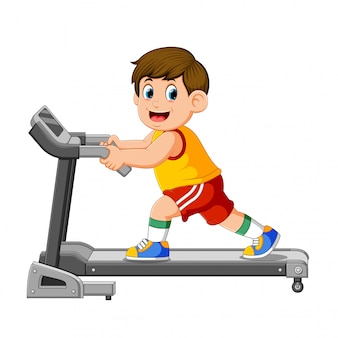 Young man in sportswear running on treadmill