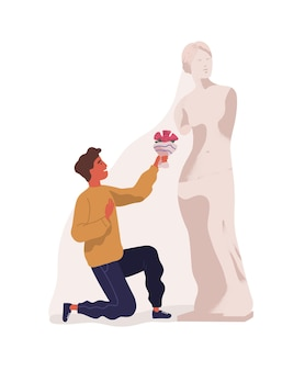 Young man standing on one knee and presenting bouquet of flowers to statue of woman