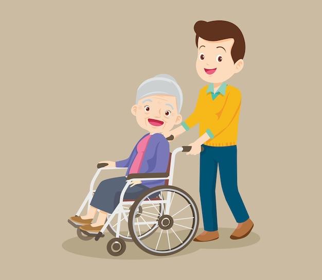 휠체어에 노인 여성과 함께 산책하는 젊은 남자
