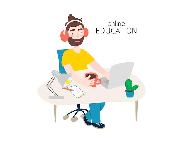 ノートパソコンで勉強している若い男