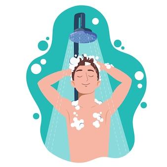 浴室でシャワーを浴びている若い男。頭、髪、体をシャンプーと石鹸で洗います。