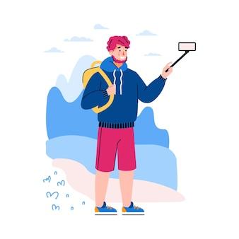 Молодой человек-путешественник-блоггер создает контент для блога в социальных сетях