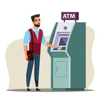 Молодой человек с помощью банкомата