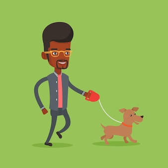 Молодой человек гуляет с собакой
