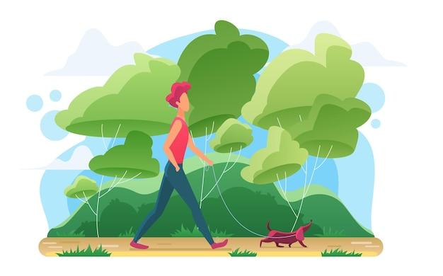 외부 자신의 개 애완 동물과 함께 산책하는 젊은 남자