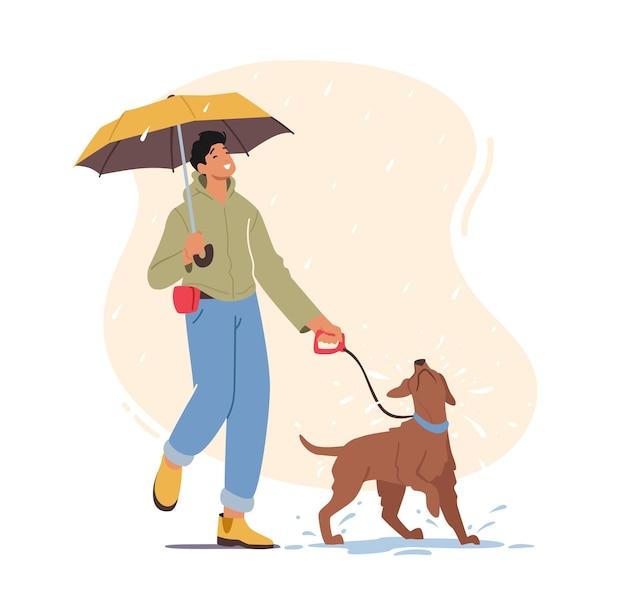 Молодой человек гуляет с игривой собакой в дождливую погоду