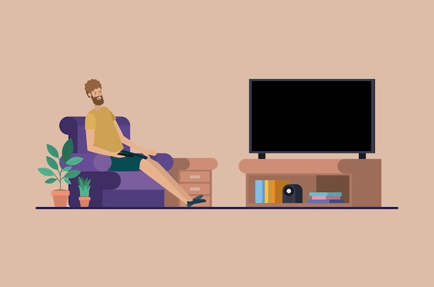 Young man watching tv on the livingroom