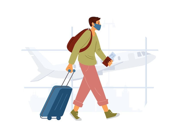 유행성 개념 동안 공항 여행에서 가방과 함께 걷는 보호 마스크를 착용하는 젊은 남자