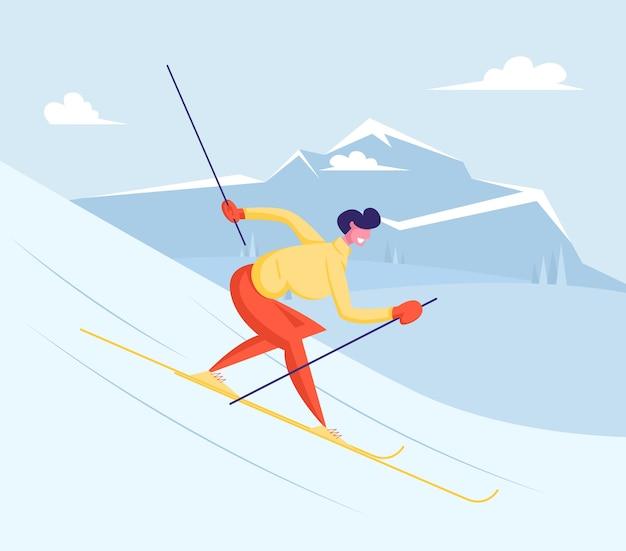 Молодой человек в теплом спортивном костюме спускается с горы