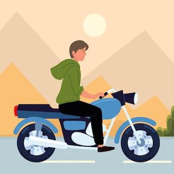 Молодой человек с мотоциклом