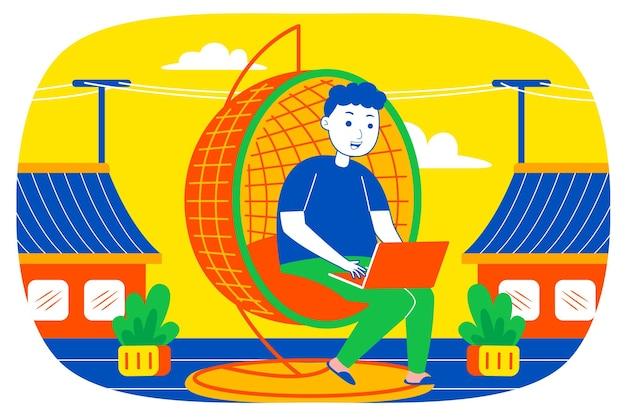 Молодой человек, работающий с ноутбуком в городском доме.