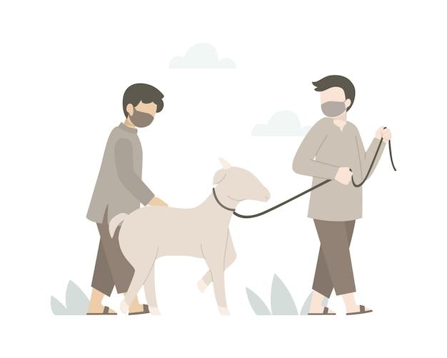 若い男性はイードアルアドハお祝いのために山羊を運んでいます