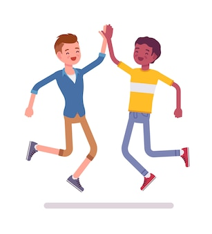 Young men jumping giving high five