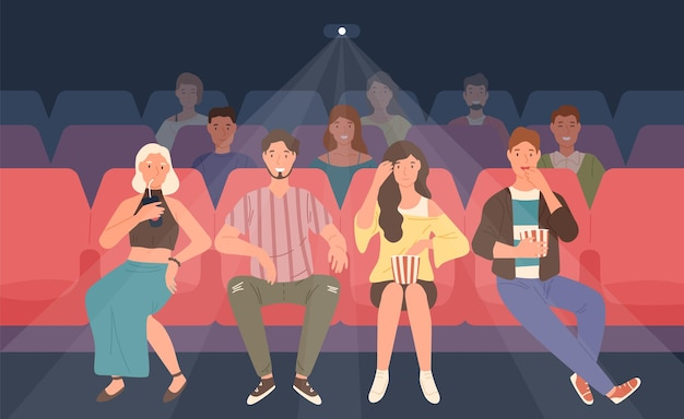 Young men and women sitting in chairs at movie theater or cinema auditorium