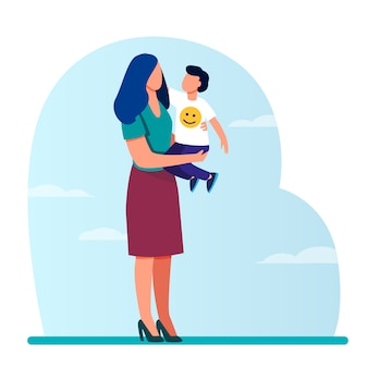 若いお母さんが腕の中で幼児の子供を保持