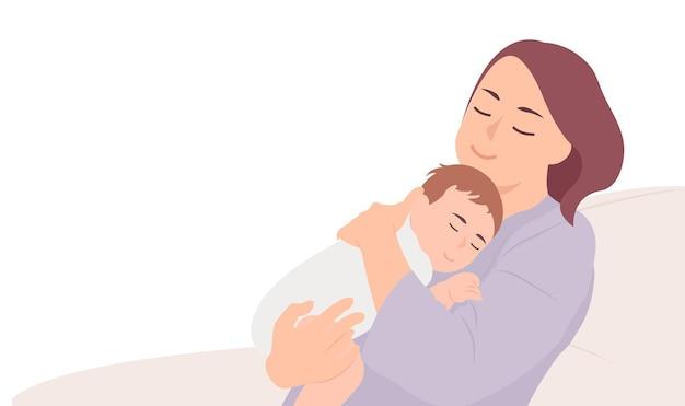 眠っている赤ちゃんを抱いて若い母親