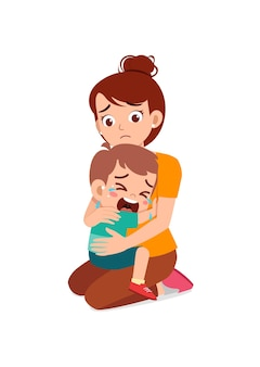 Young mother hug crying little boy and try to comfort