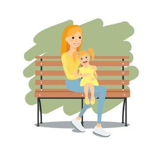 Молодая мать, сидя на скамейке с дочерью отдых и тихое время на открытом воздухе