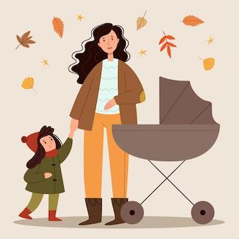Молодая мама гуляет с коляской и ребенком в парке осенняя прогулка счастливое детство