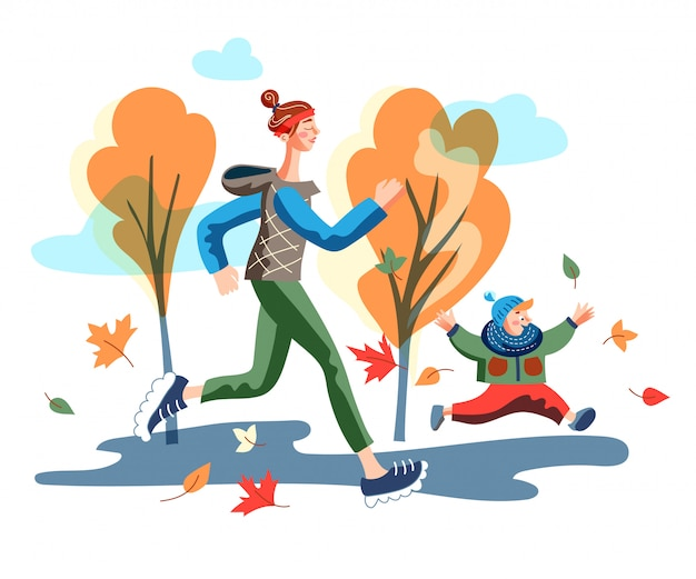 秋の公園で歩いている子供を持つ若い母親