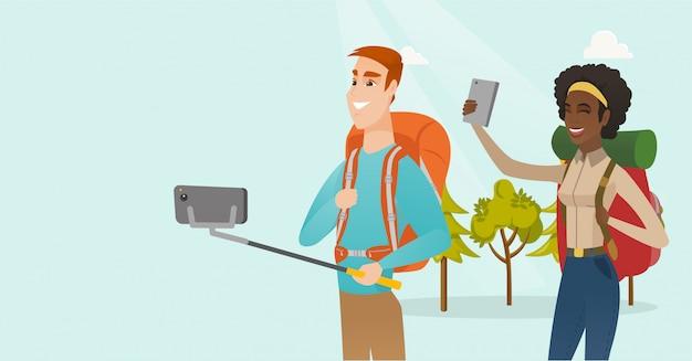 Young multiracial travelers making selfie.