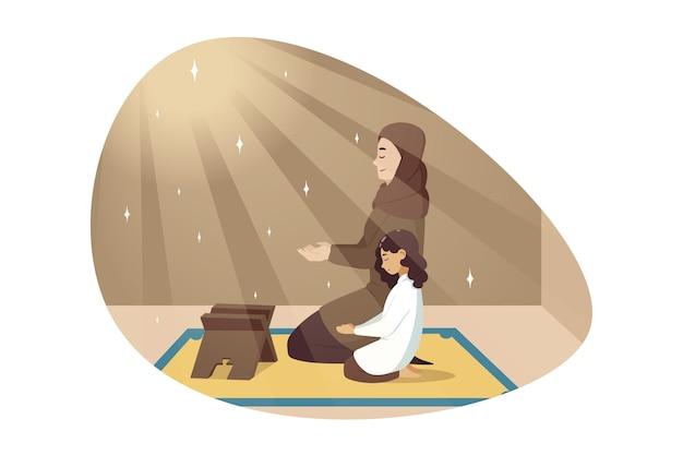 Молодая мусульманская женщина в хиджабе молится с дочерью ребенка вместе