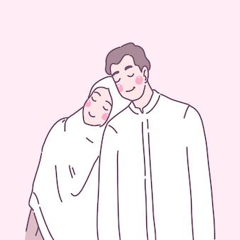 젊은 무슬림들은 서로 사랑하고 어깨에 눕습니다.