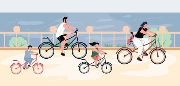바다 옆 제방에서 자전거를 타는 젊은 부모와 아이들
