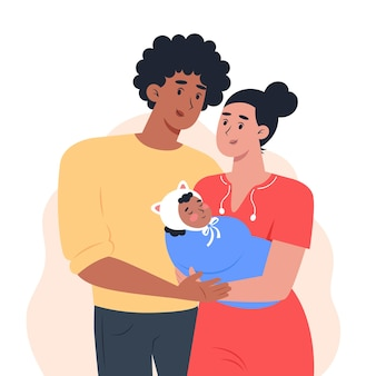 Young parents are holding a small child